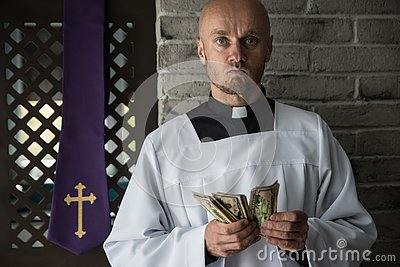 Catholic priest counting money in his hand