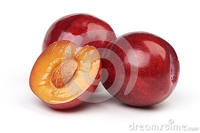 Isolated plums. One and a half of red plum fruit with leaves isolated on white background
