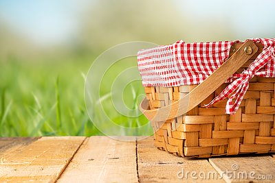 Picnic basket on a wooden table. relaxing on a picnic, and enjoyable in nature, with space