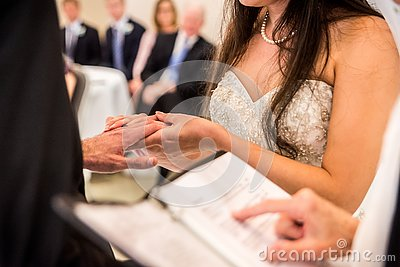 stock image of bride holding groom`s hand