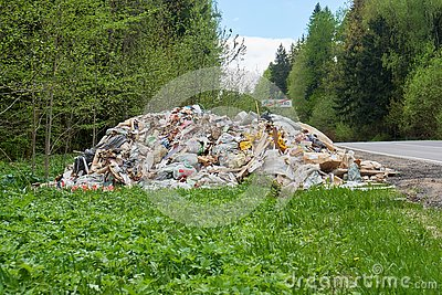 stock image of pile of garbage lying on the roadside of russian countryside road