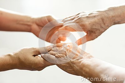 Close up hands of helping hands elderly home care. Mother and daughter