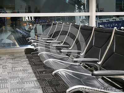 Row of empty seats in airport hall