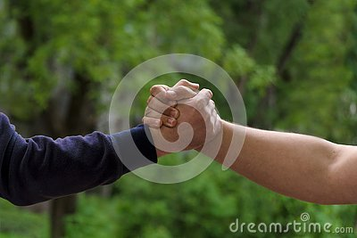 stock image of men shake hands. businessmen handshaking after good deal. concept of successful business partnership meeting . holding hands.
