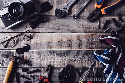 Happy fathers day concept. Top view of border of tools and ties, retro film camera on dark wooden table background. Flat lay