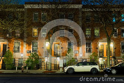 A calm and serene night scene showing an empty and quiet street in New York City`s Harlem neighborhood