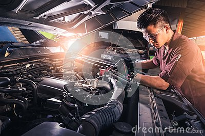The abstract image of the technician using voltage meter for voltage measurement a car`s battery. the concept of automotive, repai