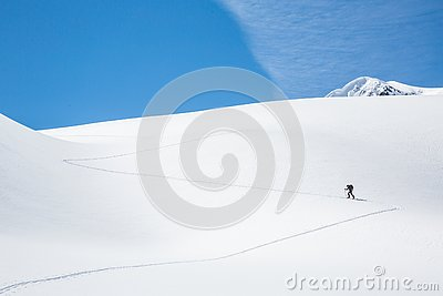 Skinning up the Asulkan Glacier in Glacier National Park, British Columbia. A man hikes on skis to access the Seven Steps to