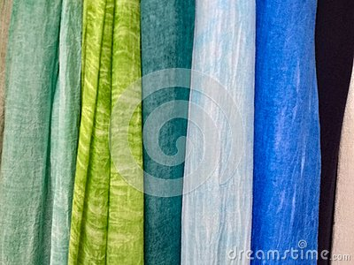 Colored background. hanging scarves of various colors