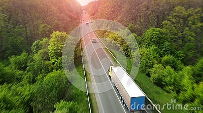 Wagon driving on the highway, aerial. Transport logistics background