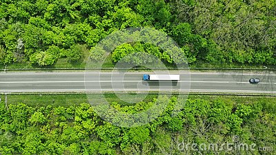 Wagon driving on the highway, aerial. Transport logistics background top view