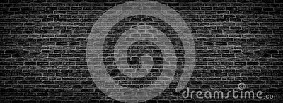 Wide black brick wall texture. Rough brickwork panorama. Dark panoramic background