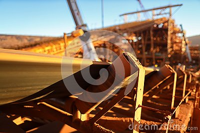 Conveyor belt and rollers structures line its transfer iron ore into material screen house construction mine site