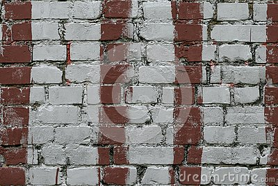 White brick wall with stripes of red paint. Old brick wall with painted red. Bricks background, pattern, texture. Grunge masonry f