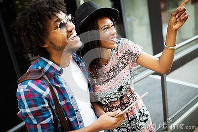 Travel, tourism, summer vacation, technology and friendship concept - smiling couple with tablet pc