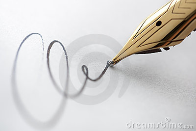 Gold pen with signature