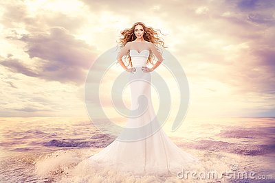 Fashion Model in Sea Waves, Beautiful Woman in Elegant White Dress Hairstyle Waving on Wind, Art Portrait