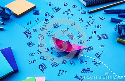 Business direction or goal concepts with boat paper and business doodle icon on worktable background