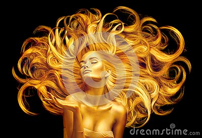 Golden beauty woman. Sexy model girl with golden makeup and long hair pointing hand over black. Metallic gold glowing skin