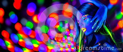 Sexy girl dancing in neon lights. Fashion model woman with fluorescent makeup posing in UV