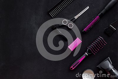Set of professional hairdresser tools with combs, sciccors and styling on black background top view mock up