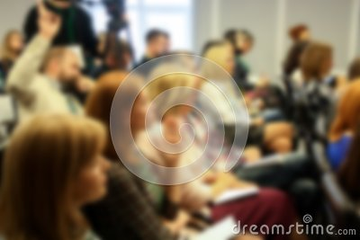 Blurred business seminar meeting in the conference hall. Defocused people