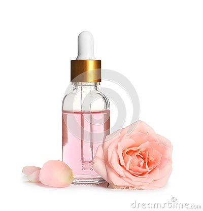 Bottle of rose essential oil and flower on white