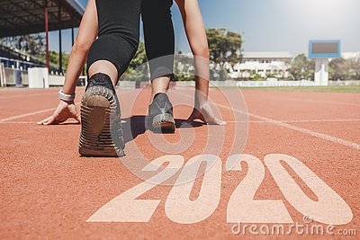 2020 Newyear , Athlete Woman starting on line for start running with number 2020 Start to new year