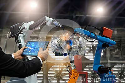 Manager engineer touch screen control automation robot arms the production of factory parts engine manufacturing industry robots a