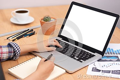 Online learning course concept. student using computer laptop with white blank screen for training online and writing lecture note