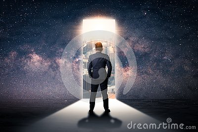 The double exposure image of the businessman standing front of the door is opening during sunrise overlay with cityscape and astro