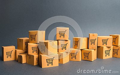 Many cardboard boxeswith drawing of shopping carts. products, goods, Warehouse, stock. commerce and retail. E-commerce, sale
