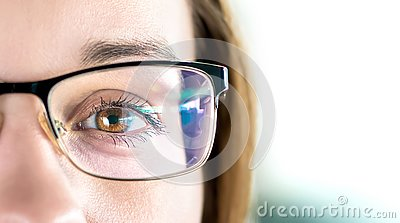 Close up of eye and woman wearing glasses. Optometry, myopia or laser surgery concept. Brown eyed girl with spectacles.
