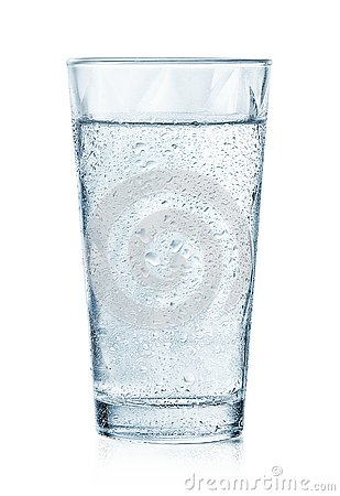 Glass of cold sparkling water with drops