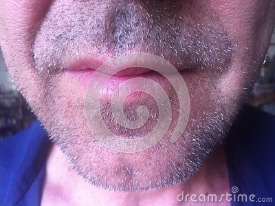 Beautiful unshaven male chin with grown stubble