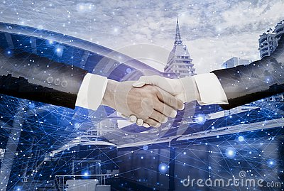 Double exposure-businessman handshake with  businesswoman deal and agree to negotiate mission complete,background cityscape with