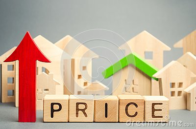 Wooden blocks with the word Price, up arrow and wooden houses. The increase in housing prices. Rising rent for an apartment. The