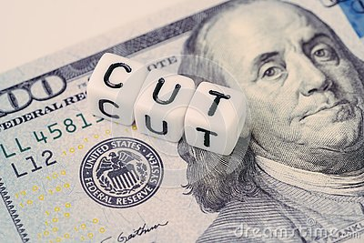 FED, Federal Reserve with interest rate cut concept, small cube block with alphabet building the word CUT next to Federal Reserve