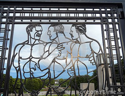 Impressive men figures on wrought iron gate with the Frogner Park in the background, Oslo, Norway