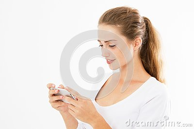 Charming joyful girl is reading pleasant text message on mobile phone from her boyfriend during her rest time. Smiling