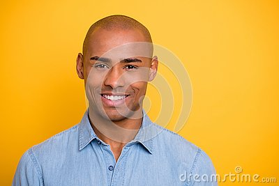 Close up photo of toothy dark skin macho positive mood wear jeans denim shirt isolated bright yellow background