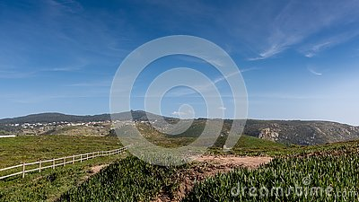 Panoramic view of mountains, meadow, grass, blue sky and clouds on a sunny day, Portugal