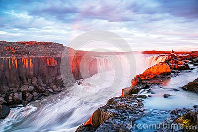 Charming beautiful waterfall Selfoss in Iceland with rainbow. Exotic countries. Amazing places. Popular tourist atraction