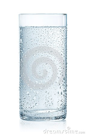 Glass of cold still water with drops