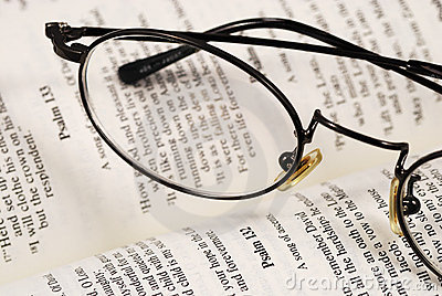 A pair of glasses on a book of knowledge