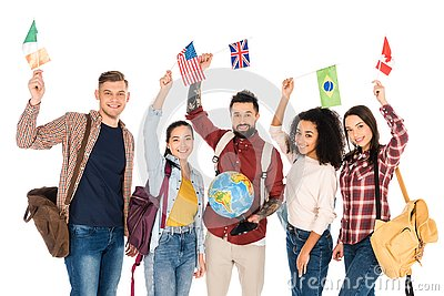 handsome man holding globe and standing with multiethnic group of people holding flags of different countries above heads isolated