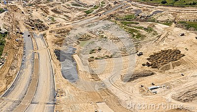 Aerial panoramic view of construction site with industrial machinery