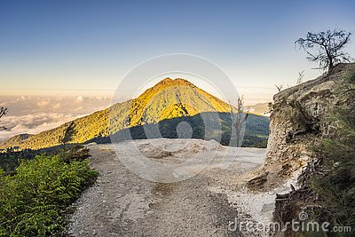 The magnificent views on green mountains from a mountain road trecking to the Ijen volcano or Kawah Ijen on the