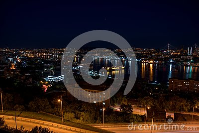 Russia, Vladivostok, August 16, 2018. Beautiful view of Golden Horn Bay with reflection of houses in the water