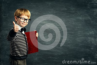 Smart Kid in Glasses, School Child Advertising Book Blank Cover, Boy showing Thumbs Up over Blackboard
